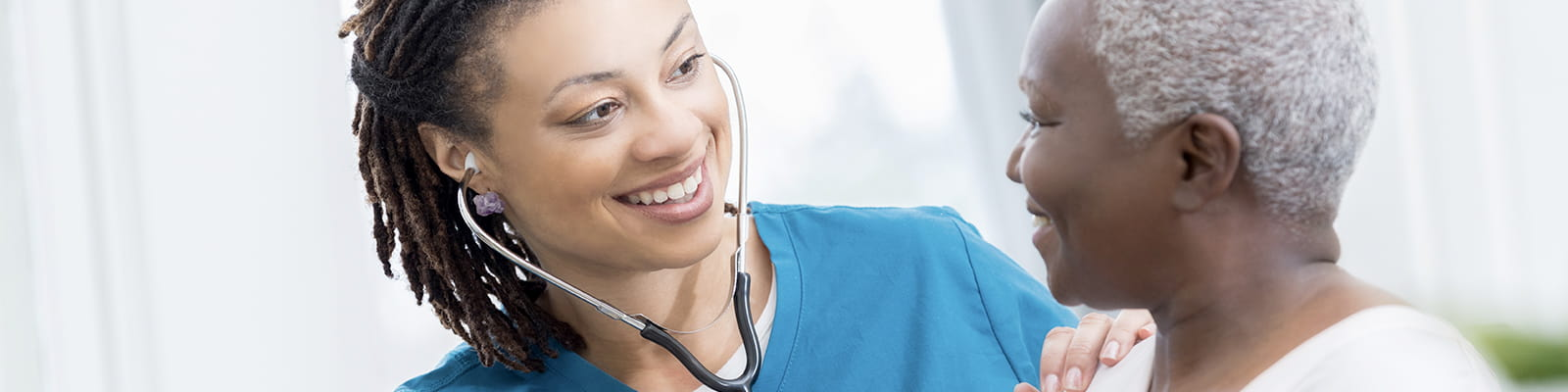 """nurse listening to patients heart"""