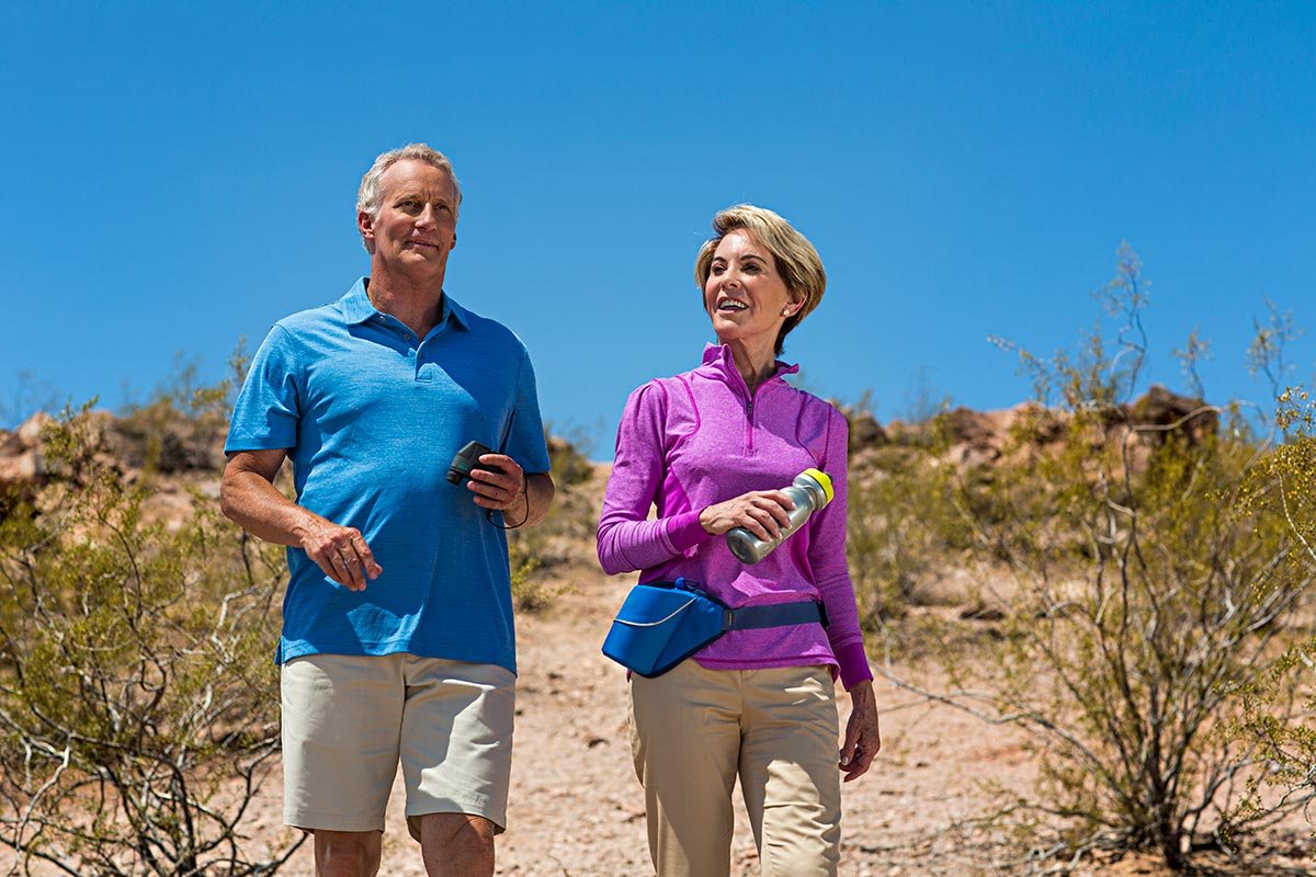 1-older-couple-walking-in-desert