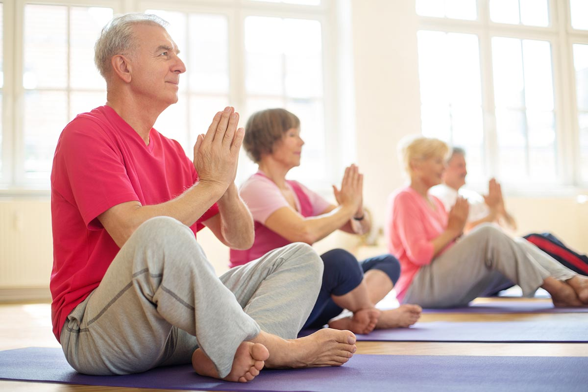 5-elderly-practicing-yoga-in-class