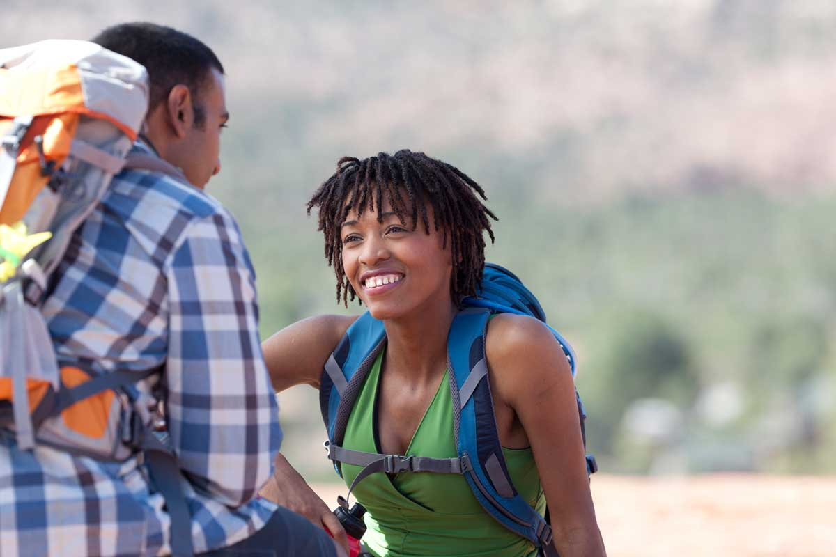 couple-talking-outdoors-while-hiking