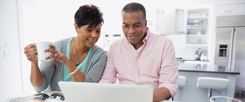 couple-reviewing-plans-on-computer