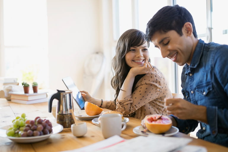 Couple enjoying breakfast at table