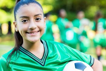 young-girl-soccer-player-holding-the-ball