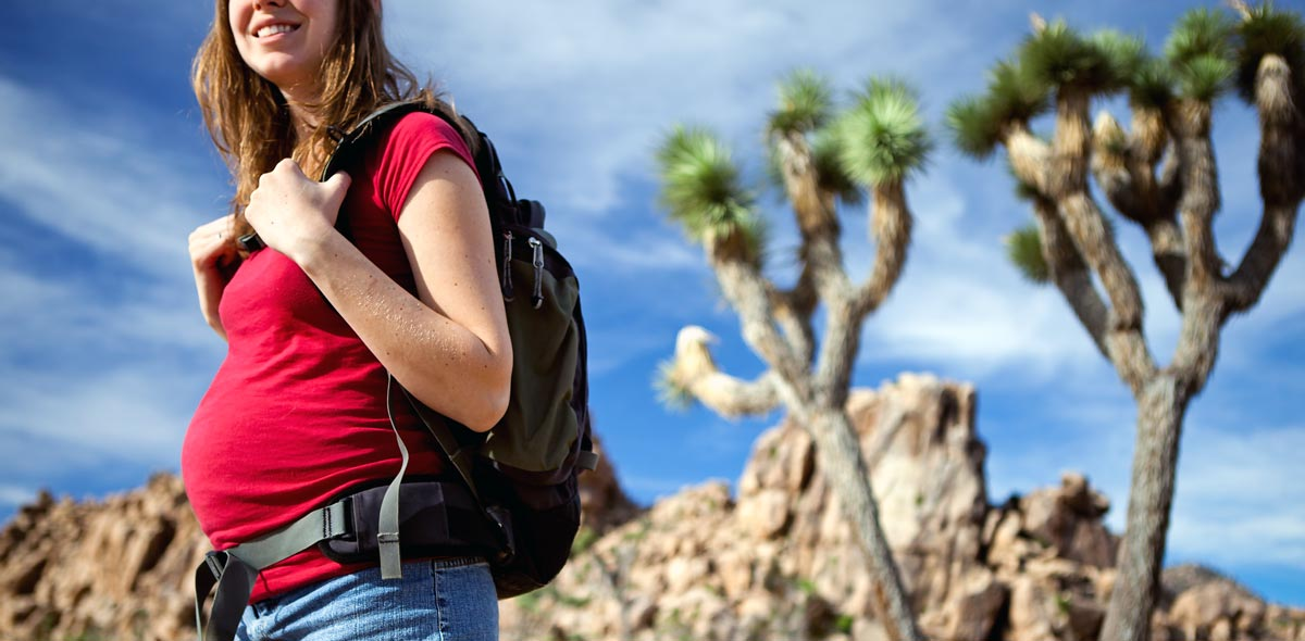 pregnant-young-woman-on-hike-in-desert
